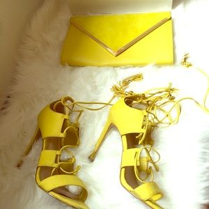 Heel sandals and clutch purse combination